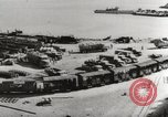 Image of trains and trucks at German military port Kerch Crimea, 1941, second 12 stock footage video 65675023586