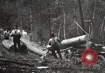 Image of workers load timber United States USA, 1926, second 10 stock footage video 65675023598
