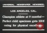 Image of man performs stunts on 9 months baby Los Angeles California USA, 1931, second 1 stock footage video 65675023610