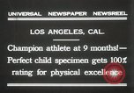 Image of man performs stunts on 9 months baby Los Angeles California USA, 1931, second 2 stock footage video 65675023610