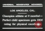 Image of man performs stunts on 9 months baby Los Angeles California USA, 1931, second 3 stock footage video 65675023610