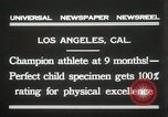Image of man performs stunts on 9 months baby Los Angeles California USA, 1931, second 5 stock footage video 65675023610