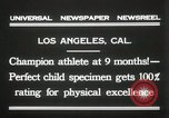 Image of man performs stunts on 9 months baby Los Angeles California USA, 1931, second 6 stock footage video 65675023610