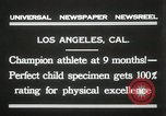 Image of man performs stunts on 9 months baby Los Angeles California USA, 1931, second 7 stock footage video 65675023610