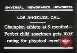 Image of man performs stunts on 9 months baby Los Angeles California USA, 1931, second 8 stock footage video 65675023610