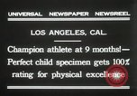 Image of man performs stunts on 9 months baby Los Angeles California USA, 1931, second 9 stock footage video 65675023610
