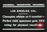 Image of man performs stunts on 9 months baby Los Angeles California USA, 1931, second 10 stock footage video 65675023610