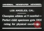 Image of man performs stunts on 9 months baby Los Angeles California USA, 1931, second 11 stock footage video 65675023610