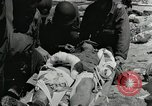Image of medics aid wounded Marines at Tarawa Tarawa Gilbert Islands, 1943, second 2 stock footage video 65675023680