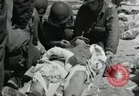 Image of medics aid wounded Marines at Tarawa Tarawa Gilbert Islands, 1943, second 3 stock footage video 65675023680