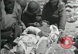 Image of medics aid wounded Marines at Tarawa Tarawa Gilbert Islands, 1943, second 4 stock footage video 65675023680