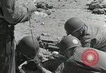 Image of medics aid wounded Marines at Tarawa Tarawa Gilbert Islands, 1943, second 5 stock footage video 65675023680