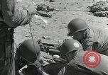 Image of medics aid wounded Marines at Tarawa Tarawa Gilbert Islands, 1943, second 6 stock footage video 65675023680