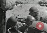 Image of medics aid wounded Marines at Tarawa Tarawa Gilbert Islands, 1943, second 7 stock footage video 65675023680