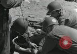 Image of medics aid wounded Marines at Tarawa Tarawa Gilbert Islands, 1943, second 9 stock footage video 65675023680