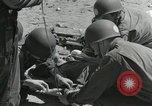Image of medics aid wounded Marines at Tarawa Tarawa Gilbert Islands, 1943, second 10 stock footage video 65675023680