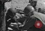 Image of medics aid wounded Marines at Tarawa Tarawa Gilbert Islands, 1943, second 11 stock footage video 65675023680