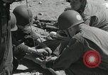 Image of medics aid wounded Marines at Tarawa Tarawa Gilbert Islands, 1943, second 12 stock footage video 65675023680
