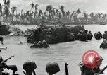 Image of wounded US soldiers at Tarawa Gilbert Islands, 1943, second 10 stock footage video 65675023681