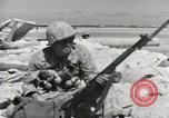 Image of war scenes form battle of Tarawa Gilbert Islands, 1943, second 5 stock footage video 65675023682