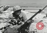 Image of war scenes form battle of Tarawa Gilbert Islands, 1943, second 7 stock footage video 65675023682