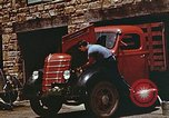 Image of trucker in Harlan Harlan Kentucky USA, 1942, second 2 stock footage video 65675023739
