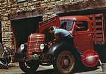 Image of trucker in Harlan Harlan Kentucky USA, 1942, second 8 stock footage video 65675023739
