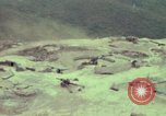 Image of 155mm howitzer slung beneath a CH-54 helicopter Vietnam, 1969, second 5 stock footage video 65675023785