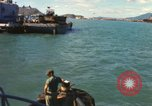 Image of Army tugboat with barge Vietnam, 1967, second 8 stock footage video 65675023886