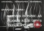 Image of Treasury Building burning on Nanking Road Shanghai China, 1932, second 1 stock footage video 65675023914