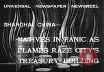 Image of Treasury Building burning on Nanking Road Shanghai China, 1932, second 2 stock footage video 65675023914