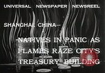 Image of Treasury Building burning on Nanking Road Shanghai China, 1932, second 3 stock footage video 65675023914