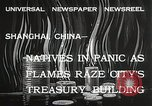 Image of Treasury Building burning on Nanking Road Shanghai China, 1932, second 10 stock footage video 65675023914
