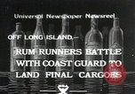 Image of Coast Guard pursue bootlegger in prohibition Long Island New York USA, 1933, second 1 stock footage video 65675023920