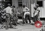 Image of Negro students learning to sow plants and build a shed Alabama United States USA, 1921, second 5 stock footage video 65675023995