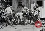 Image of Negro students learning to sow plants and build a shed Alabama United States USA, 1921, second 9 stock footage video 65675023995