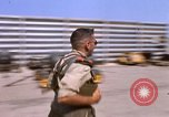 Image of U.S. Marine F-8E crusader  being armed with rockets Da Nang Vietnam, 1967, second 10 stock footage video 65675024121