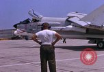 Image of US Marine Corps F-8E Crusader aircraft take off on a mission Da Nang Vietnam, 1967, second 6 stock footage video 65675024125