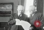 Image of Eisenhower and Dulles in White House Washington DC USA, 1955, second 2 stock footage video 65675024226
