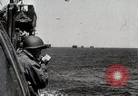 Image of The D-Day invasion battle on the beaches  Normandy France, 1944, second 1 stock footage video 65675024431