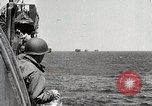 Image of The D-Day invasion battle on the beaches  Normandy France, 1944, second 3 stock footage video 65675024431