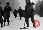 Image of American Troops use mine detectors in snow Germany, 1944, second 7 stock footage video 65675024444