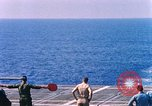 Image of US Marine Corps UH 34D helicopter lands on deck Cape Canaveral Florida USA, 1962, second 2 stock footage video 65675024593