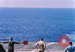 Image of US Marine Corps UH 34D helicopter lands on deck Cape Canaveral Florida USA, 1962, second 5 stock footage video 65675024593