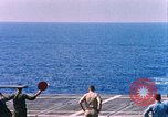 Image of US Marine Corps UH 34D helicopter lands on deck Cape Canaveral Florida USA, 1962, second 7 stock footage video 65675024593