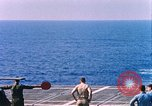 Image of US Marine Corps UH 34D helicopter lands on deck Cape Canaveral Florida USA, 1962, second 8 stock footage video 65675024593