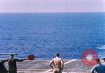 Image of US Marine Corps UH 34D helicopter lands on deck Cape Canaveral Florida USA, 1962, second 9 stock footage video 65675024593
