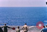Image of US Marine Corps UH 34D helicopter lands on deck Cape Canaveral Florida USA, 1962, second 12 stock footage video 65675024593