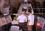 Image of astronauts in procedure trainer United States USA, 1960, second 6 stock footage video 65675024631
