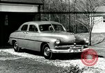 Image of family showing Lincoln-Mercury car Long Island New York USA, 1949, second 1 stock footage video 65675024712